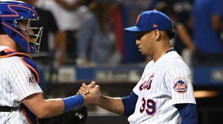 Mets relief pitcher Edwin Diaz and catcher James