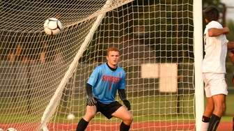 Cole Nevins of Syosset watches the penalty kick
