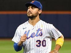 Mets rightfielder Michael Conforto runs to the dugout