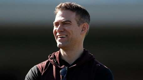 Cubs president of baseball operations Theo Epstein looks