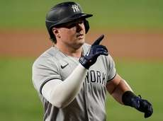 The Yankees' Luke Voit gestures while running the