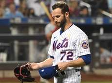 Mets relief pitcher Jake Reed walks to the