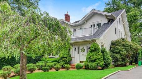 Priced at $1.699 million, this five-bedroom, 3½-bath traditional