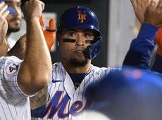 Mets second baseman Javier Baez is greeted in