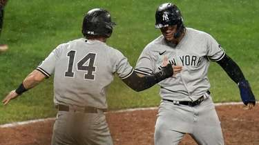 The Yankees' Tyler Wade and Gleyber Torres celebrate