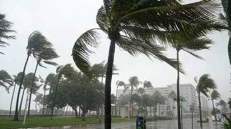 An approaching tropical storm drenches Ocean Drive on