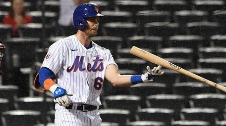 Mets left fielder Jeff McNeil reacts after he