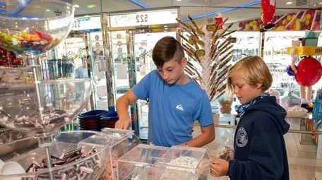 Michael Gowen and Erik Kristiansen, 11, shop at