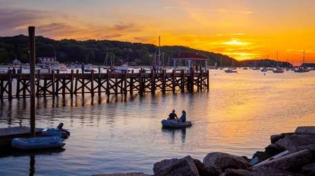 The sun sets over the Northport dock in
