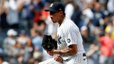 Jonathan Loaisiga of the Yankees reacts after the