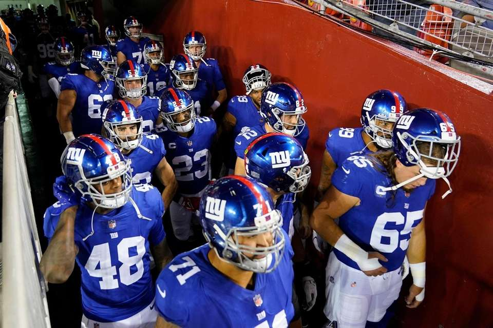 Members of the New York Giants wait in