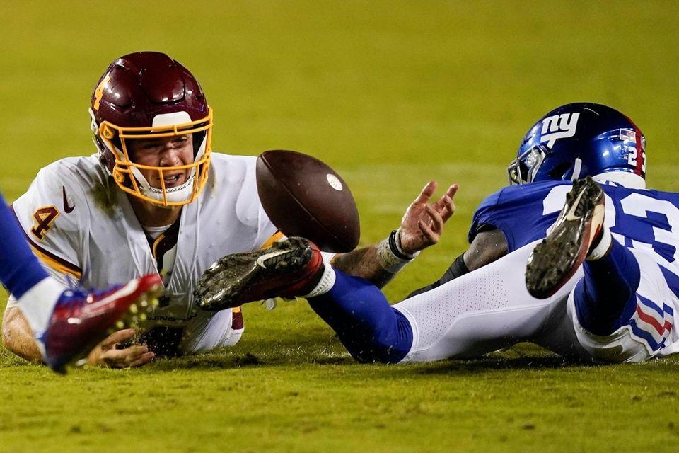 Washington Football Team quarterback Taylor Heinicke (4) looses
