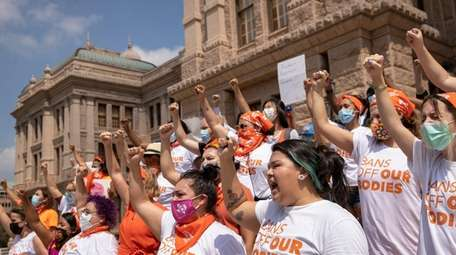Women protest the new abortion law at the