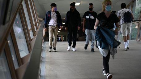 Hofstra University students walk the halls on the