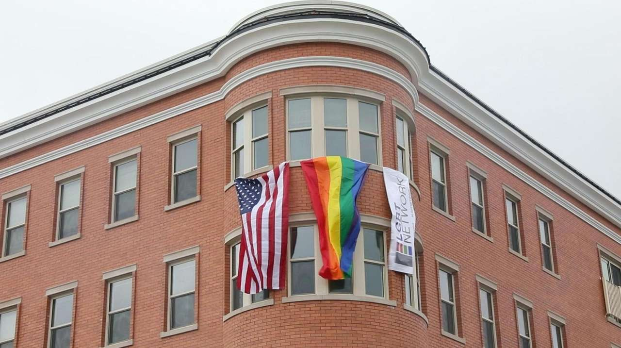 Local officials and LGBT community leaders gathered for