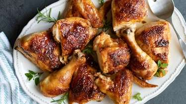 Chicken is sprinkled with spices and basted with