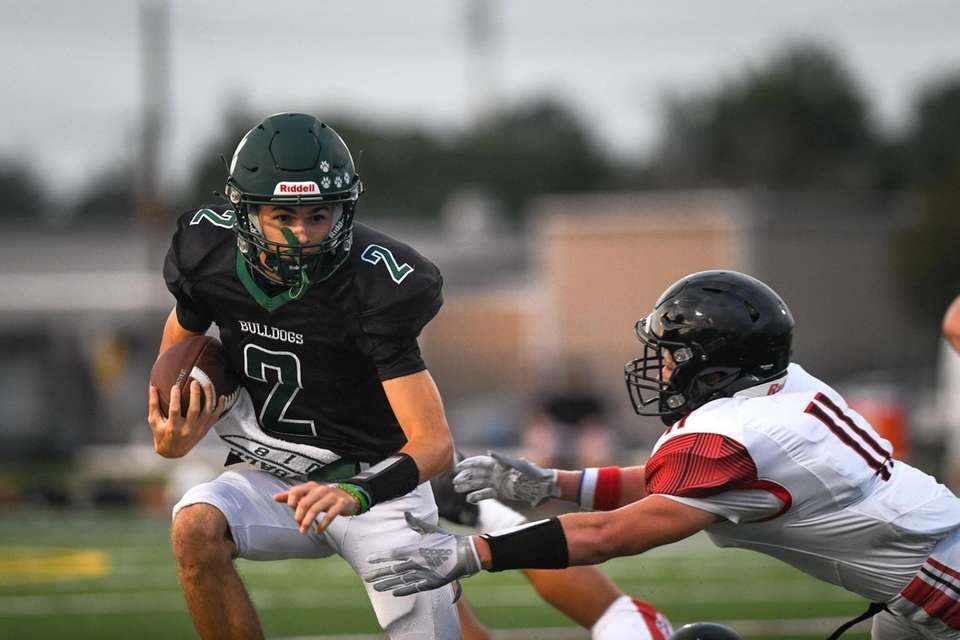 Brenden O'Connor of Lindenhurst looks to outrun the