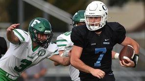 Oceanside quarterback Charlie McKee picks up yards on
