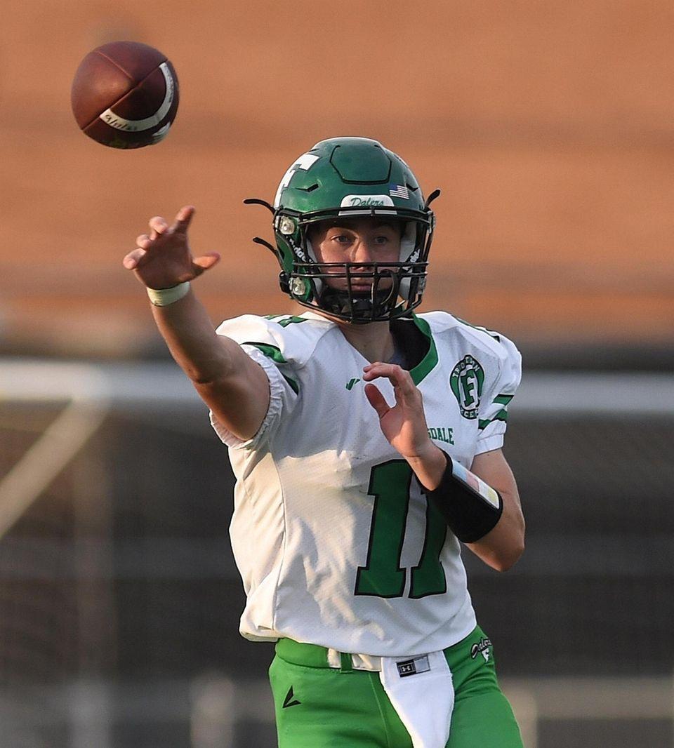 Kyle Wilson, Farmingdale quarterback, throws a pass during