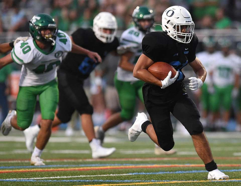 Cole Parker of Oceanside rushes for a long