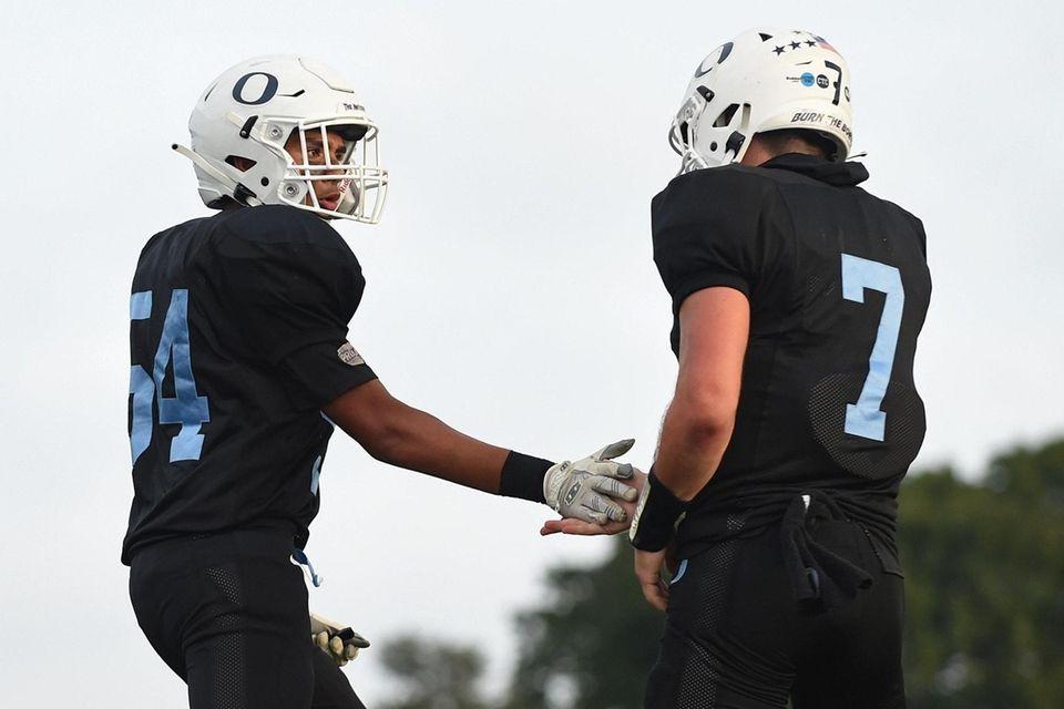 Justin Alvarez of Oceanside, left, and quarterback Charlie