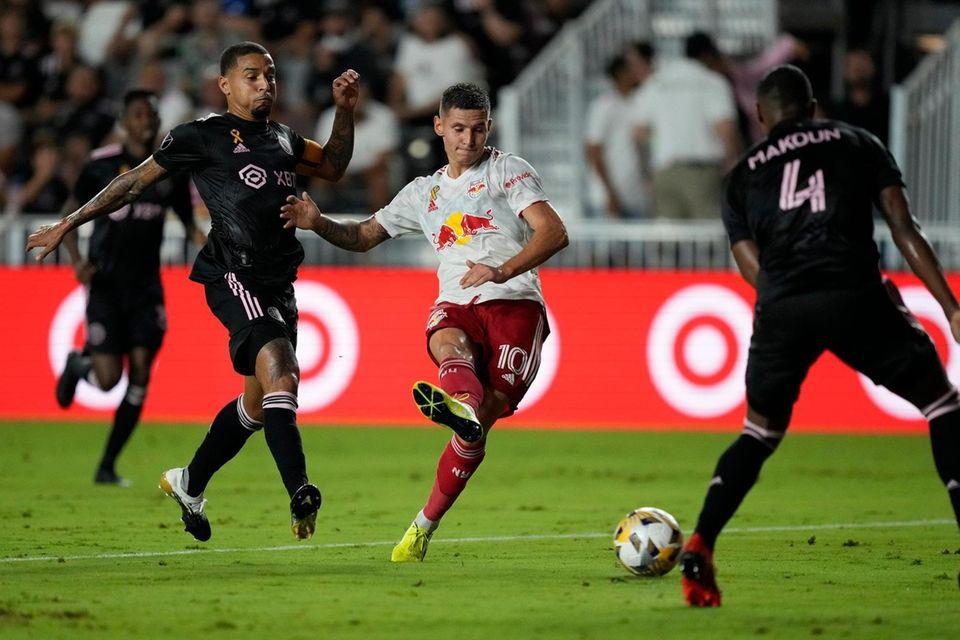 Red Bulls forward Patryk Klimala shoots while defended