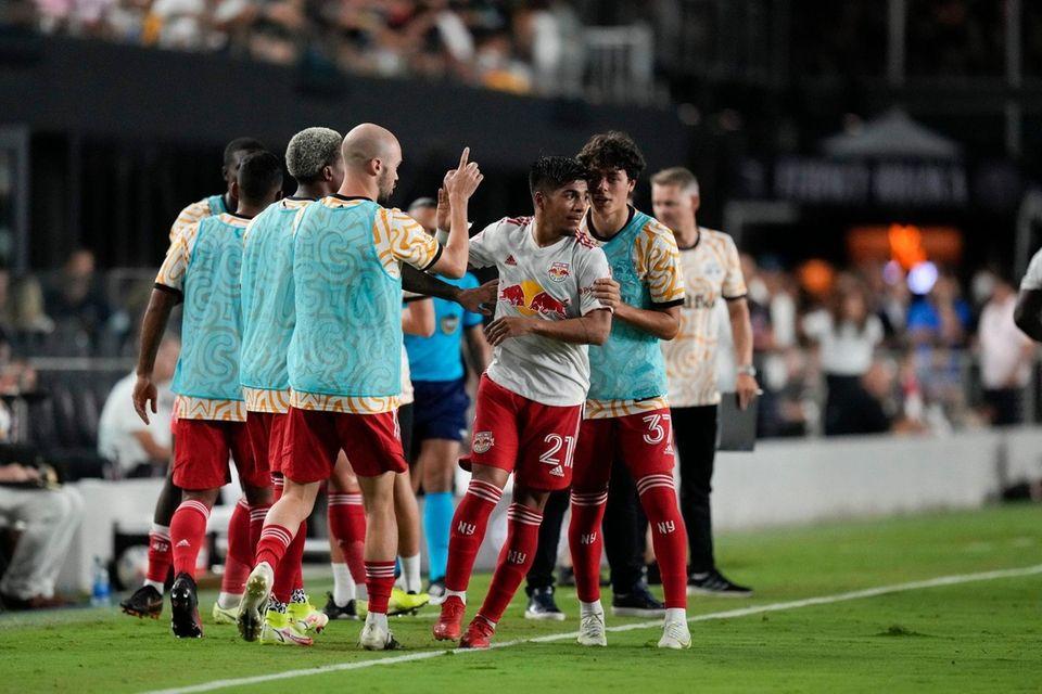 Red Bulls midfielder Omir Fernandez, center, is congratulated