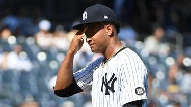 \Yankees starting pitcher Luis Gil reacts against Cleveland