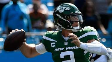 Zach Wilson of the Jets throws a pass