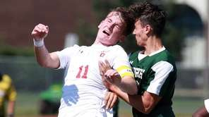 Connetquot's #11 Kevin Johnson heads the ball during