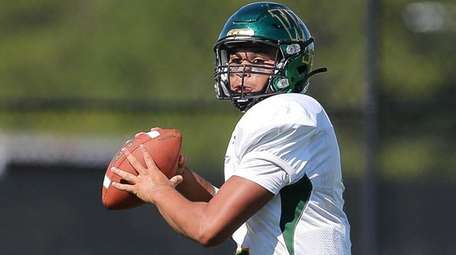 Ward Melville's Chris Prussen looks to pass in