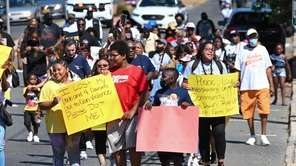 Residents of Wyandanch gathered to march against gun