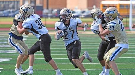 Tyler Martini of Wantagh gets good protection as