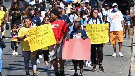 Residents march along Straight Path in Wyandanch Saturday,