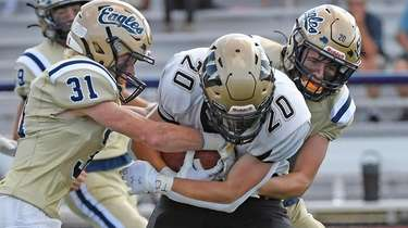 Bethpage defenders Anthony Cucurullo (31) and Justin Crumb