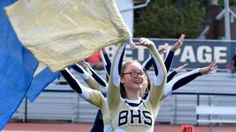 The Bethpage flag team entertains during halftime of