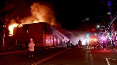 Firefighters battle a blaze at the corner of