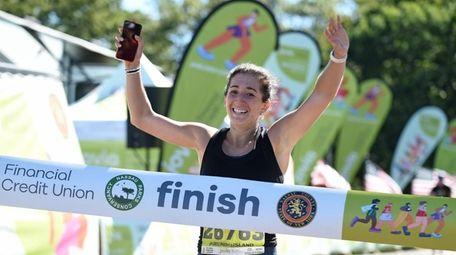 Rebecca Margolin of Syosset crosses the finish line