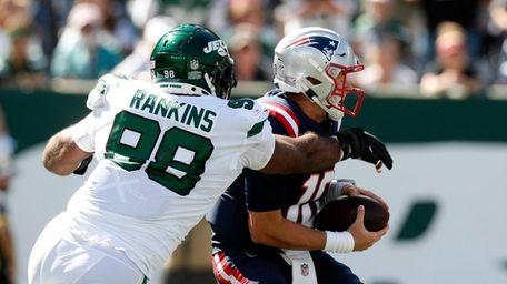 Sheldon Rankins #98 of the Jets sacks Mac