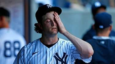 Yankees starting pitcher Gerrit Cole reacts in the