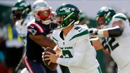 Zach Wilson #2 of the Jets runs the