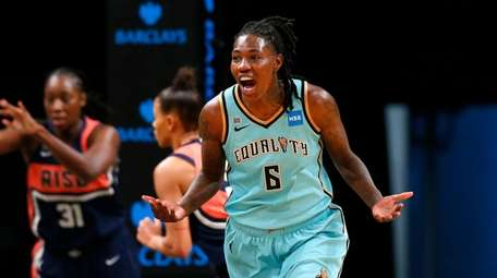 Liberty forward Natasha Howard (6) reacts after scoring