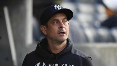 Yankees manager Aaron Boone looks on from the