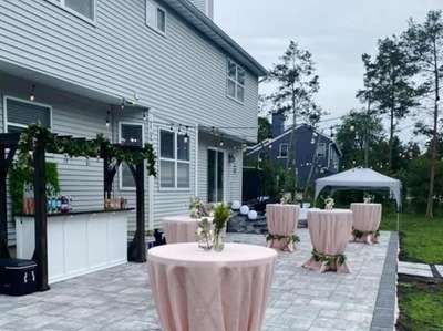 Tables dressed with pink linens and hugged with