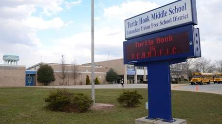 Three students at Uniondale's Turtle Hook Middle School