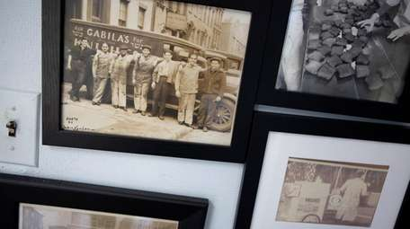 Photographs on display at Gabila's Knishes factory in