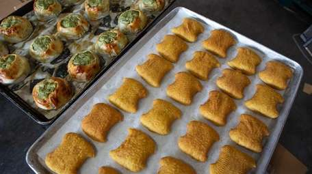 Fried potato knishes, right, and baked spinach knishes
