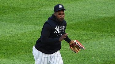 New York Yankees pitcher Luis Severino walks to