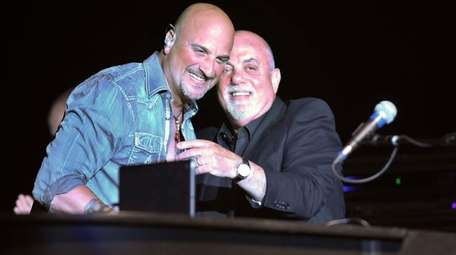 Billy Joel, right, made a surprise appearance at