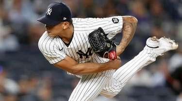 Jonathan Loaisiga of the Yankees pitches against the